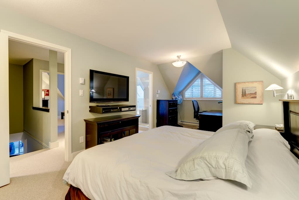 Bright master bedroom with TV and Ensuite Bathroom