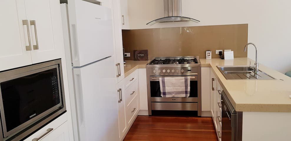 The kitchen in the main space also features a dishwasher and Nespresso coffee machine, microwave etc.
