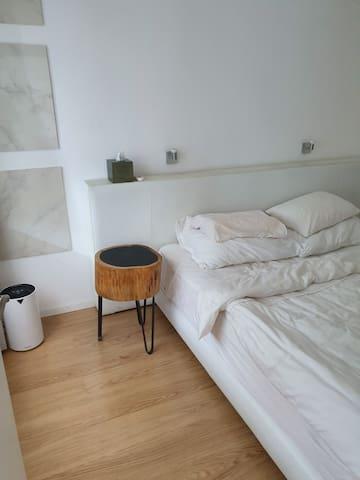 master bedroom with extra cosy designers  top notch Treca de Paris bed for 2 persons.