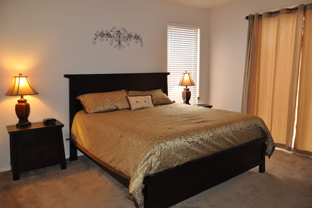 Master bedroom with en-suit bath and a king sized bed