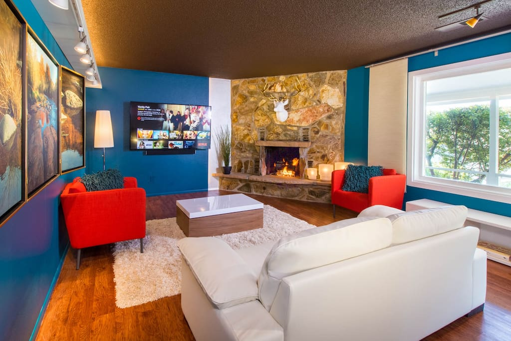 "Living room with Fireplace, 70"" Streaming TV, light installations & Art"