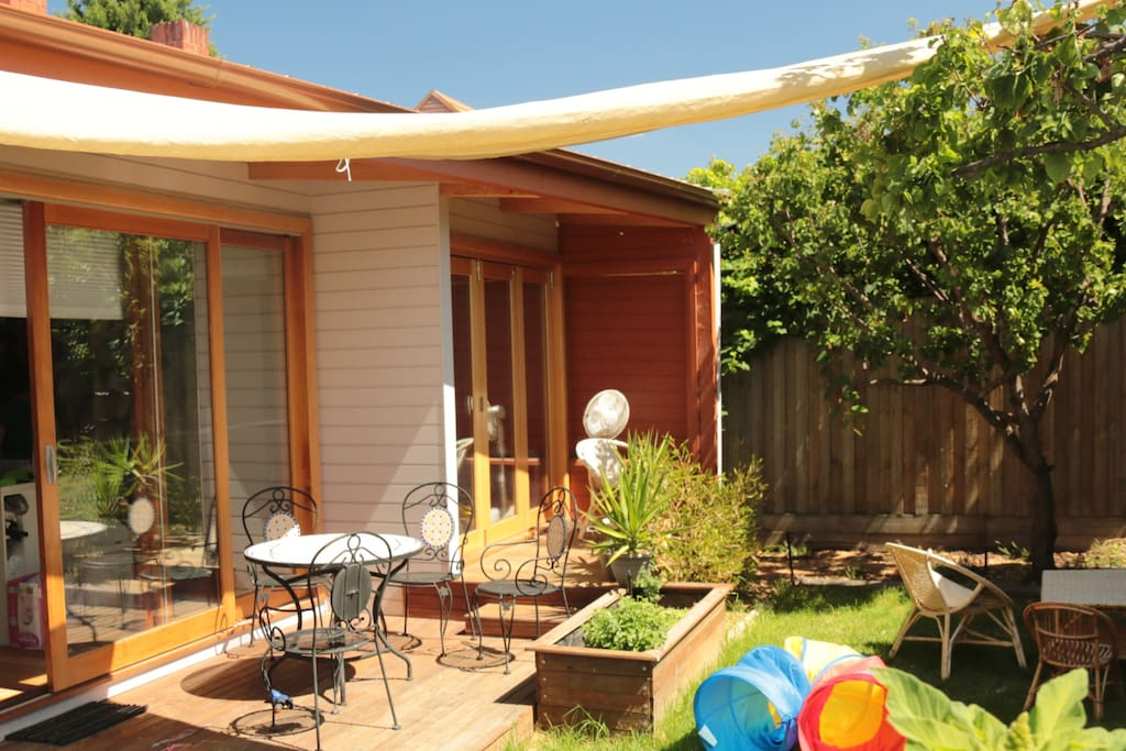Sunny north facing backyard with deck, BBQ (in summer) and outside setting