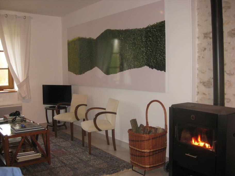Enjoy the wood-burning stove in the spacious living area