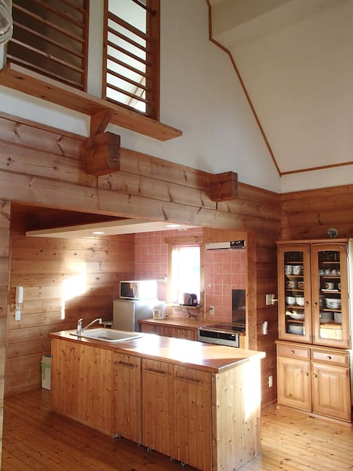 The high ceilings in the living area make the cabin feel airy and spacious