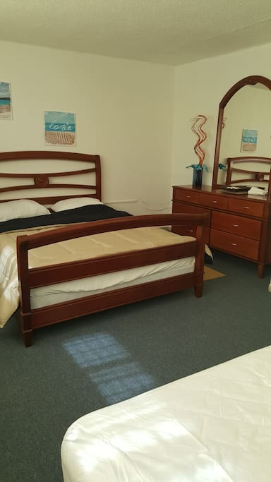 bedroom with one queen bed and one twin bed