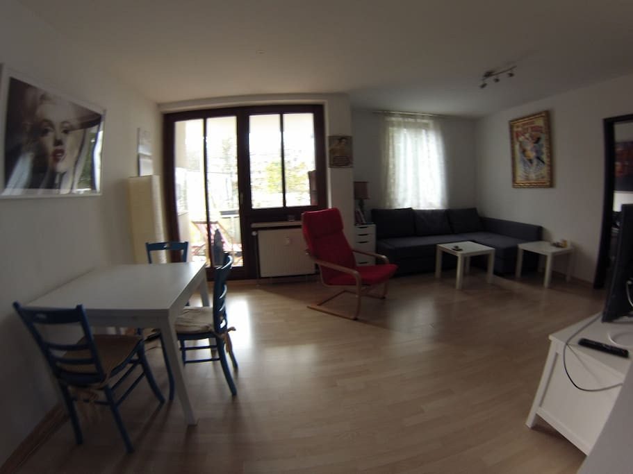 open kitchen/living room with balcony