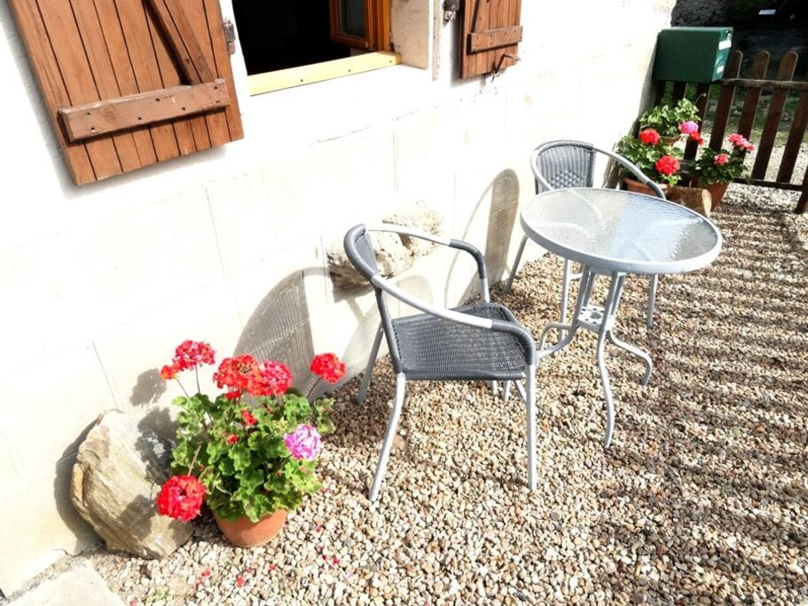 Bistro table seating in front of the gite