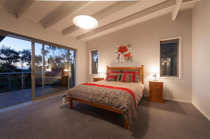 Master Bedroom, access to deck and full sea view