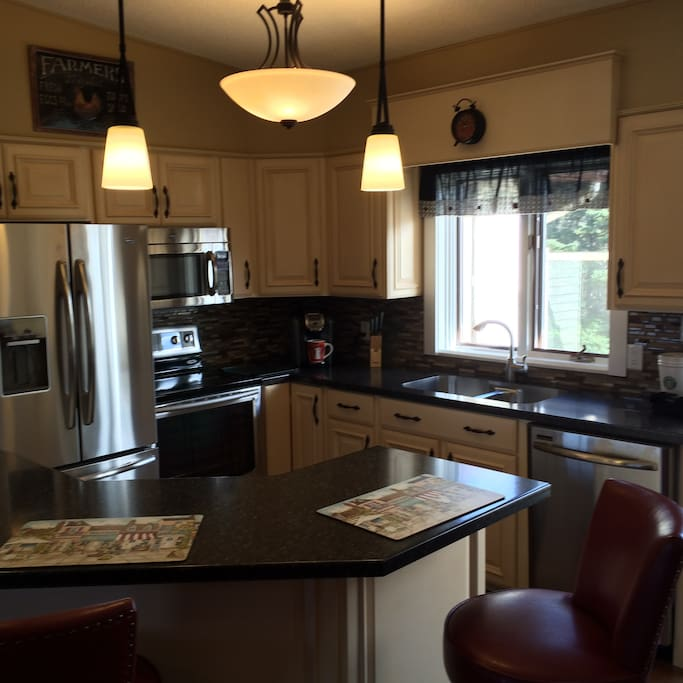 full kitchen, frig with water and ice maker, oven with glass cooktop/oven, microwave/vent, dishwasher, K-cup carafe.