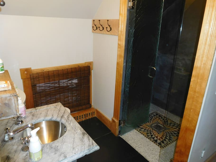 Steam shower, locally sourced slate walls and floor