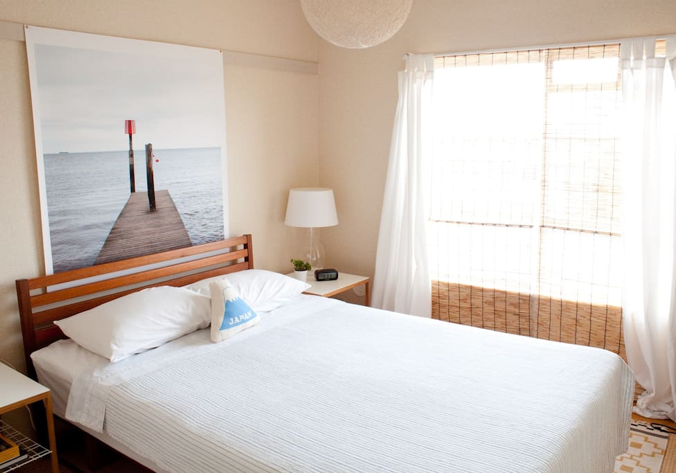 The bedroom with a comfy bed and great view of Kanamachi.