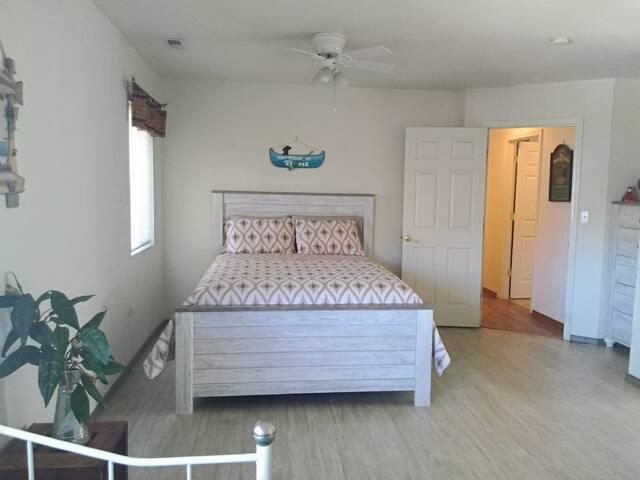 Queen bed in large master bedroom