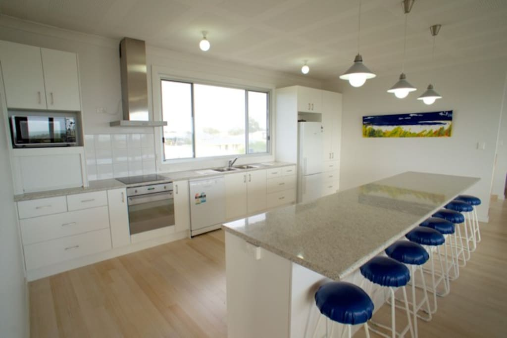 Large kitchen with Electric oven and cook top, microwave and dishwasher.