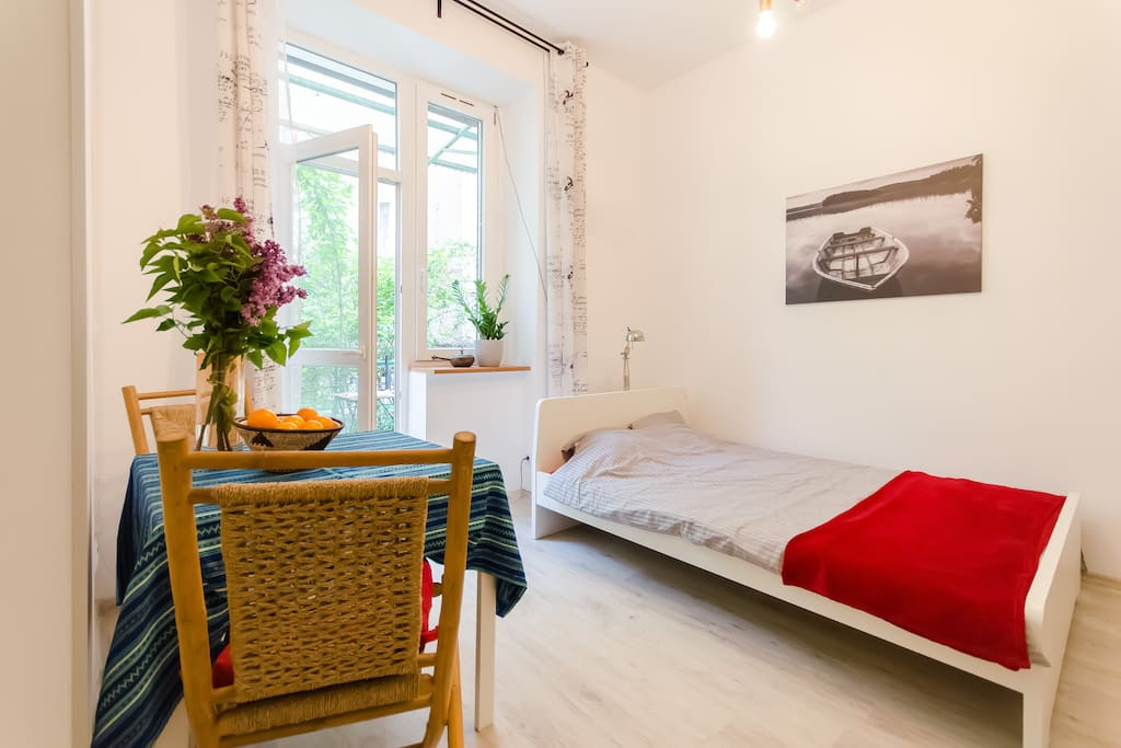 The studio apartment faces internal courtyard giving you quiet, secluded athmosphere. You will bless old, thick walls made of bricks wchich will cool the air in the summer and prevent cold in the winter.