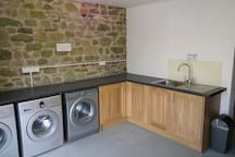We have a dedicated laundry room with 2 machines and one tumble dryer.