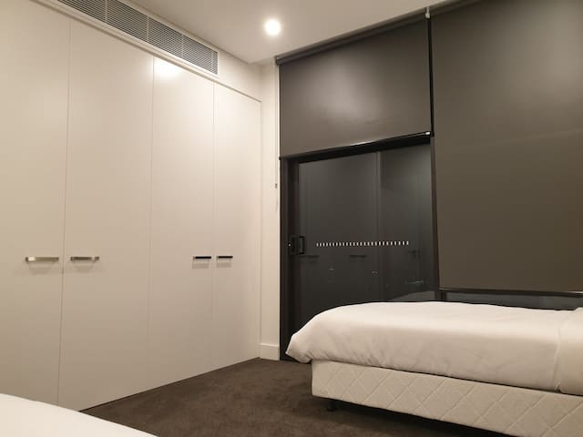 Olympic Park Penthouse bedroom & a Panoramic View
