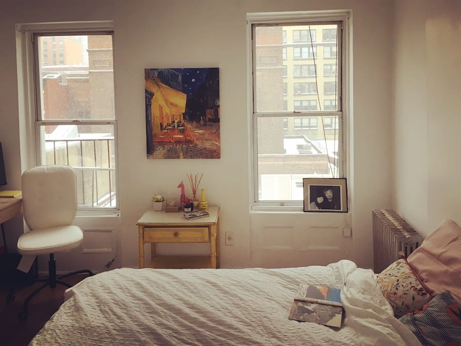 Light-filled and huge (!) bedroom with a full bed, built-in bookcase, twinkle lights, desk, skyscraper views