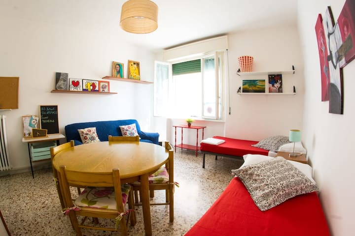 The colorful living room with two more beds