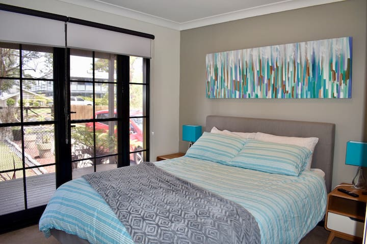 Master bedroom with wardrobes and tv