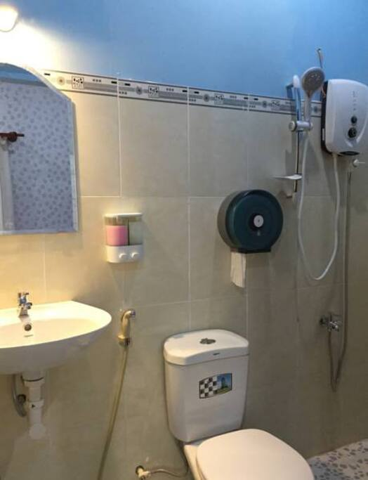 Private toilet with hot water machine for shower