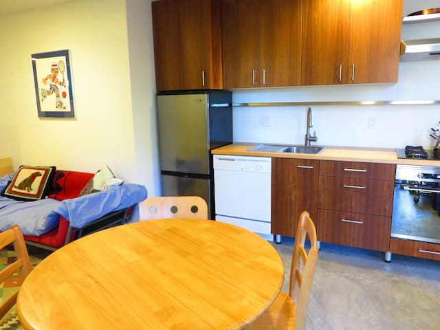 Small dining table seats 4, full kitchen with gas stove, oven, microwave, dishwasher, etc.