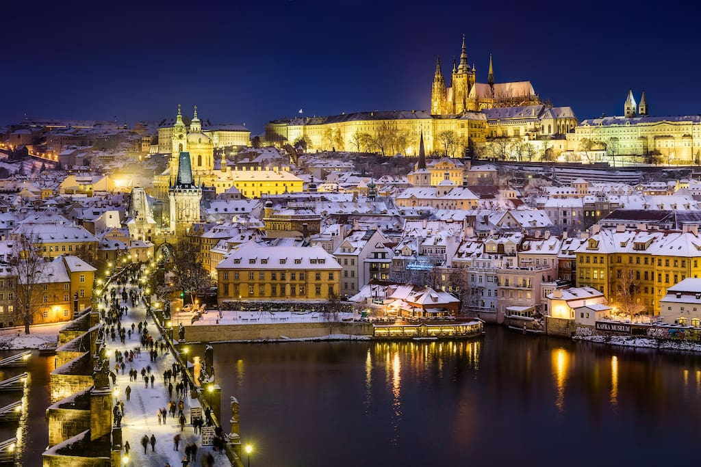 Prague castle and Charles Bridge during winter season.