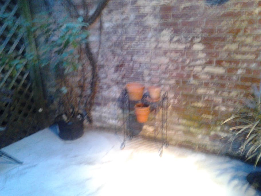 outside patio. includes grill and a few chairs, small table