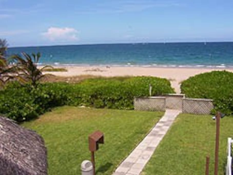 View from your balcony, across the patio, the lawn and out to the sand.
