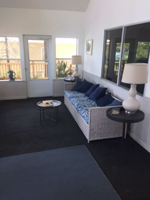 4 season sun porch with couch and dining/game table