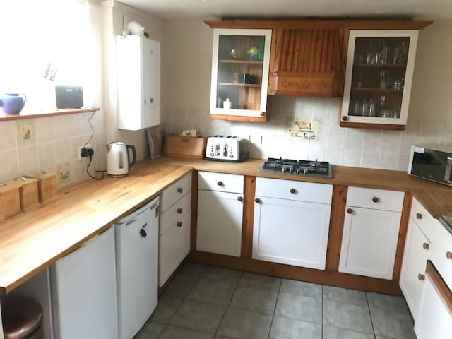 Country kitchen with dishwasher, microwave,  kettle, toaster and cooking equipment, tea, coffee  etc