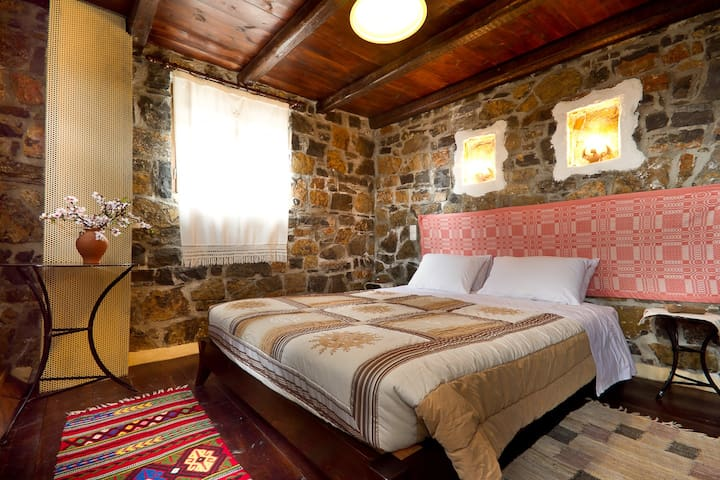 "Traditional stone built guest house ""Aivali"""