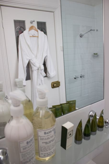Beautiful en suite bathroom with bathrobes and quality guest amenities.