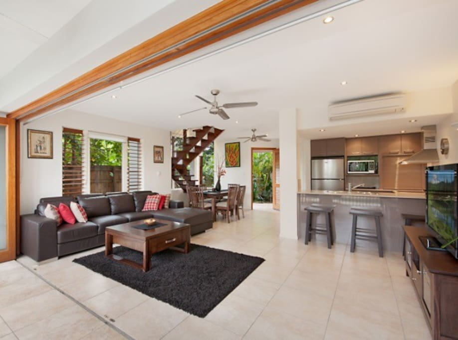 Open plan living area with lounge, dining and kitchen