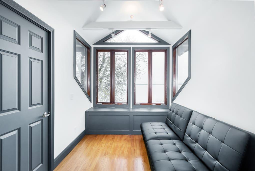 Lake view sun room in master bedroom