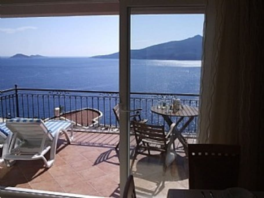 Patio doors running virtually the width of the lounge giving a feeling of expansiveness and light.The doors open to a terrace with stunning views of the bay.