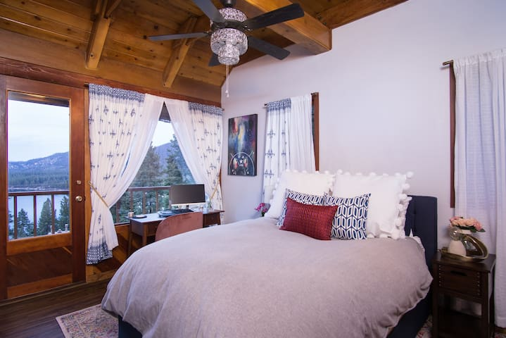 Guest Queen Bedroom - Desk workstation with one of the best views in the house, HDTV with cable and private deck access with sitting area.