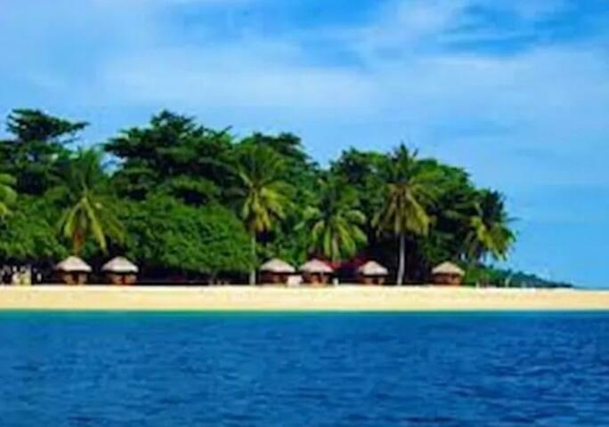 Kaputian beach day tour in a hut