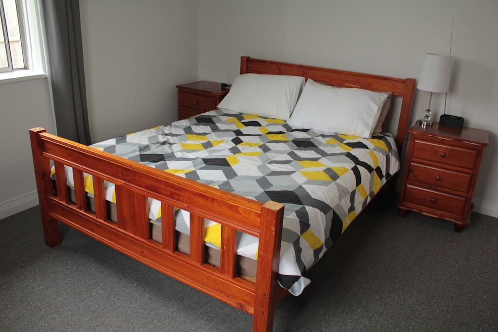 This is the master bedroom which has a very comfortable queen size bed, bed side draws and wardrobe for you convenience.