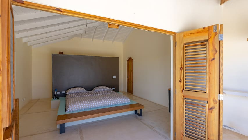 Bedroom left side: king, bathroom with sink, toilet, shower, closets, AC.