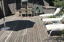 Sunbrellas available for lounge chairs and dining area.