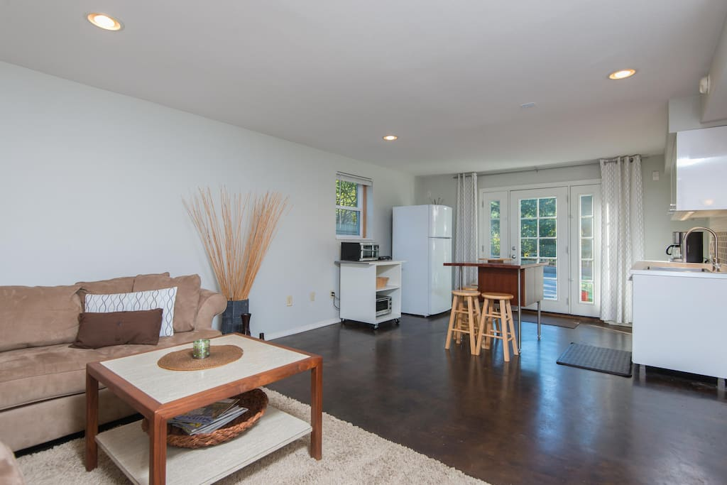 Open floor plan with stained concrete floors