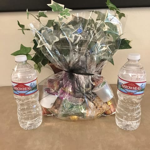 "Complimentary ""Welcome"" gift bag filled with treats and water bottles to greet you as you arrive"