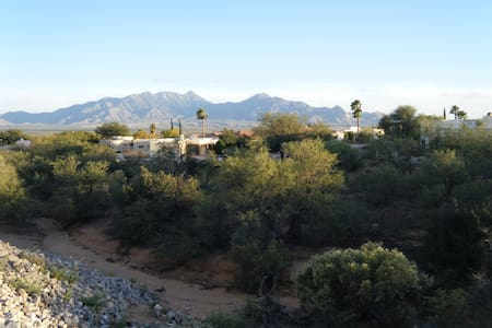 End T/H; SW furn., 2br/2ba/2 car garage; spot-on views of Santa Ritas; walk to G.V. Village, restaurants, shopping; pools;  satillo tile, great patio for birding in adjacent arroyo; 16' ceiling; kiva fireplace; all kitchen amenities; walk in shower
