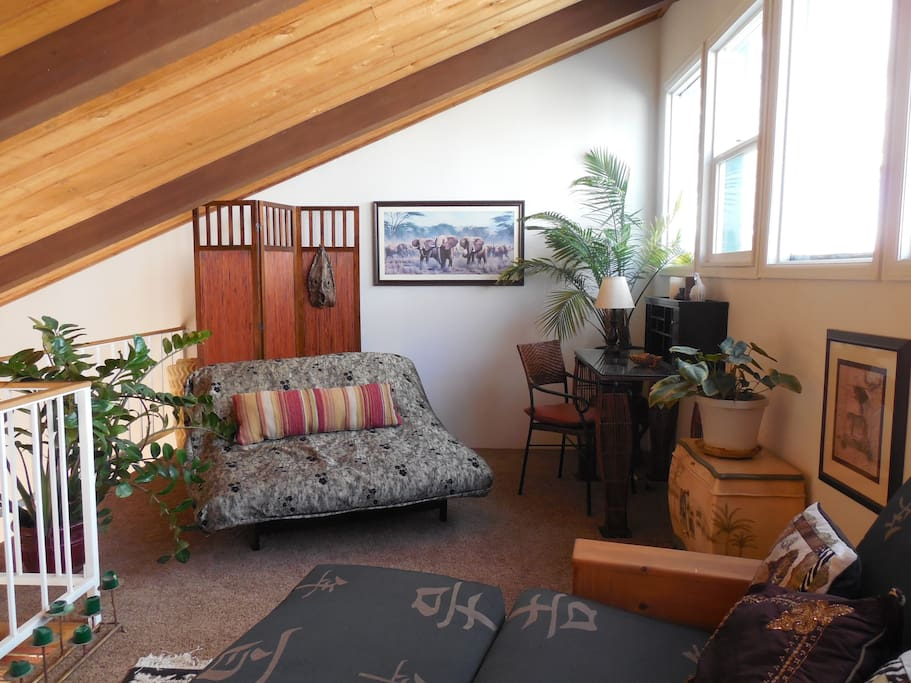 Comfy bright loft with two futons