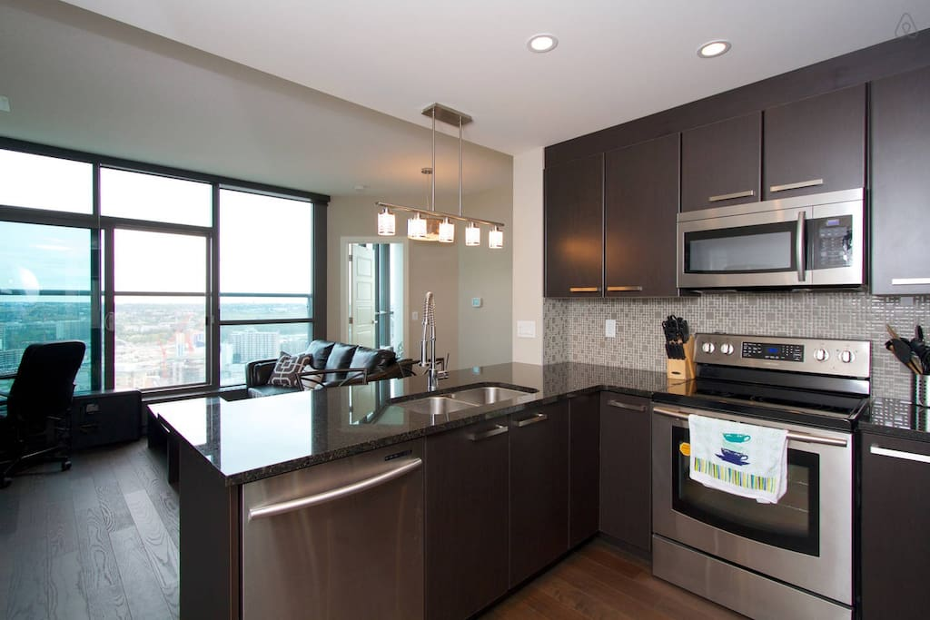 Open concept kitchen, looking out to the living room and amazing view