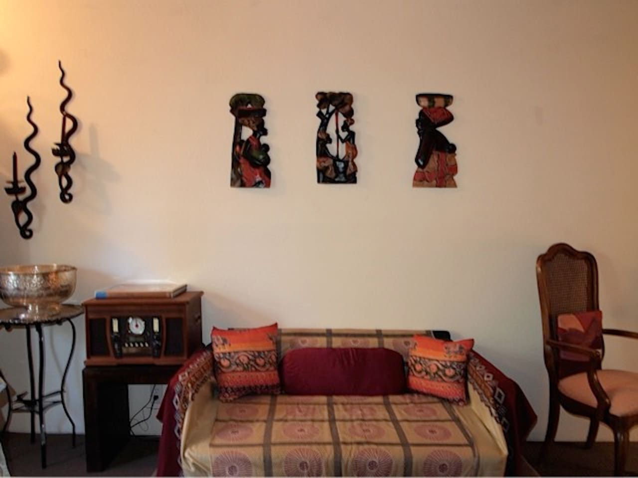 Couch and African artwork.