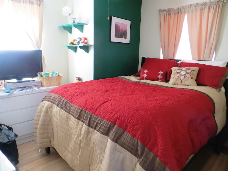 Bedroom: Queen-sized bed, TV/DVD/VHS, with a cedar lined closet.
