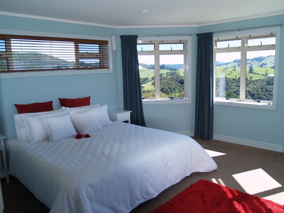 Luxurious King Bedroom with views to the hills and sea.  Both rooms have sea views.