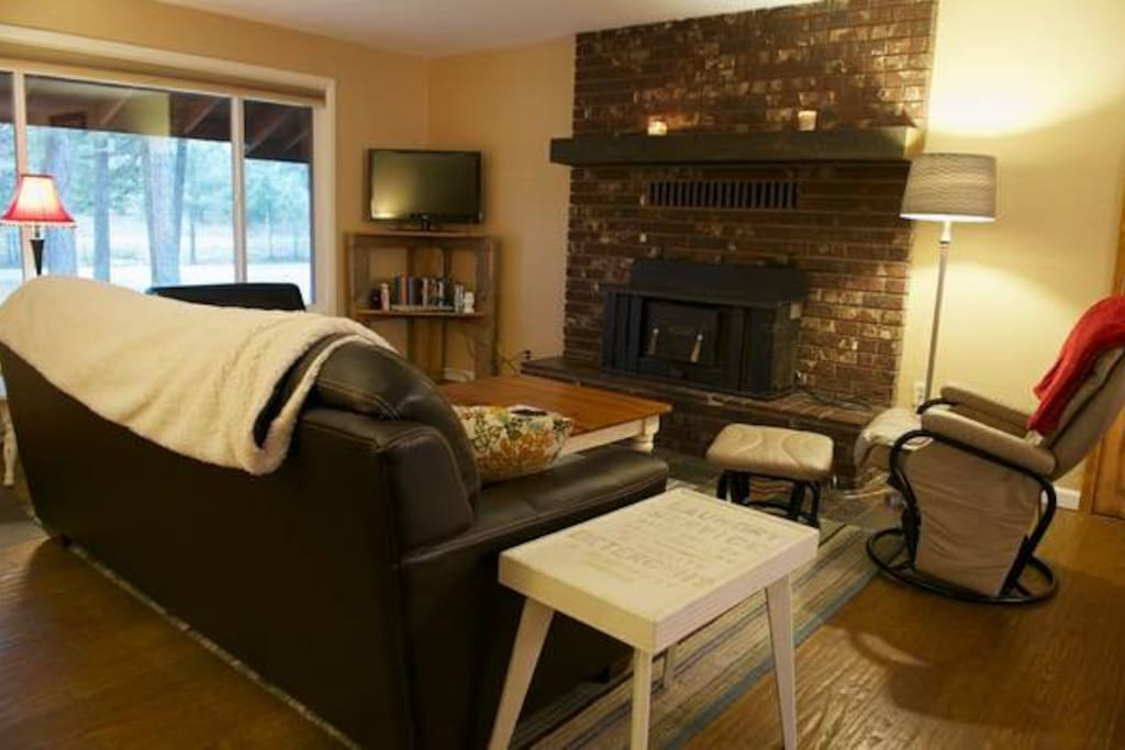 Cozy living room with gas fireplace & tv with cable and dvd player