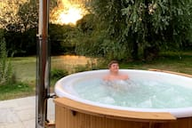 Enjoy Brook Farm's Swedish woodfired hot tub with lakeside views